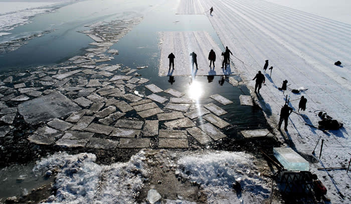 An aerial view shows floating ice blocks cut from the frozen surface of Xiuhu lake in Shenyang, northeastern China's Liaoning province on December 20, 2017. The ice blocks are used as part of winter tourism activities in the region. / AFP PHOTO / - / China OUT-/AFP/Getty Images