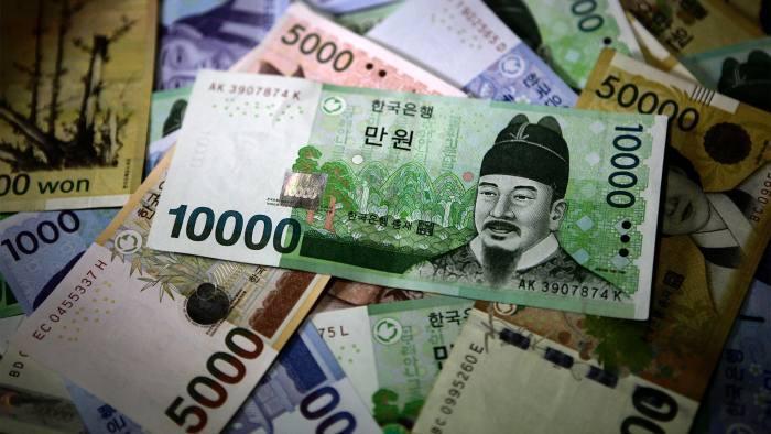 South Korean won banknotes of various denominations are arranged for a photograph in Seoul, South Korea, on Tuesday, Dec. 11, 2012