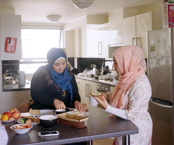 Sisters Waed, left, and Anwar preparing food