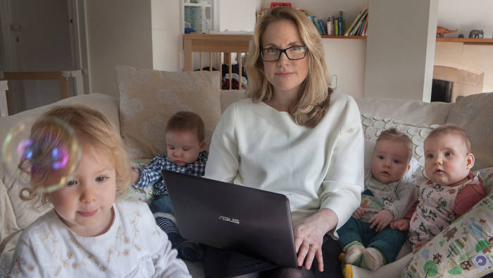 Sarah Cook working from home and looking after her 4 Children, 3 of whom are triplets. 12/10/16 . Copyright Photo Tom Pilston.