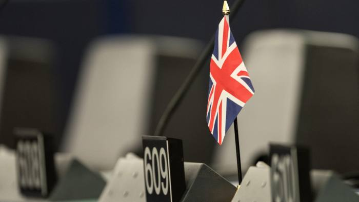 epa05408243 A single British flag sits on a desk during a debate in the European Parliament in Strasbourg, France, 05 July 2016. The European Parliament met to review the Brexit summit conclusions and the past Dutch EU presidency. All member nations of EU take part in the rotating six-month EU presidency that is currently held by Slovakia.  EPA/PATRICK SEEGER