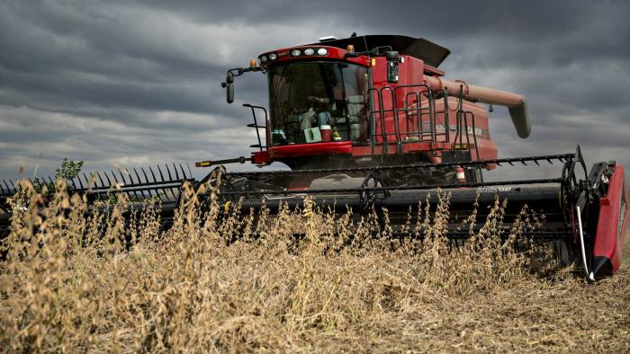 Syngenta Group Co. NK Soybeans are harvested with a Case IH combine harvester near Tiskilwa, Illinois, U.S., on Thursday, Sept. 29, 2016. U.S. farmers are predicted to harvest a third straight record crop of soybeans this year. Photographer: Daniel Acker/Bloomberg