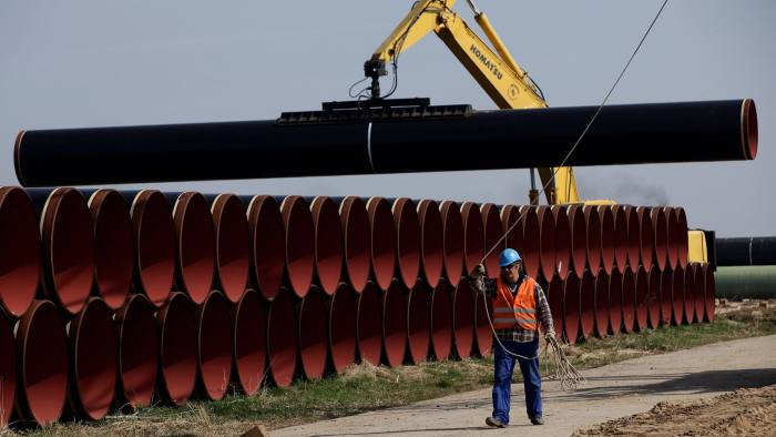 LUBMIN, GERMANY - APRIL 08: A worker walks past sections of pipe that will be used in the OPAL pipeline on April 8, 2010 near Lubmin, Germany. The OPAL and NEL pipelines will carry natural gas from Russia arriving through the Nord Stream pipeline from the Baltic Sea across Germany and to other countries in Europe. The Nord Stream project delivers Russian natural gas directly to western Europe and avoids countries in between, such as Poland and Ukraine. (Photo by Sean Gallup/Getty Images)