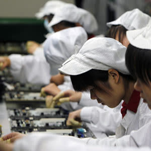 staff members work on the production line at the Foxconn complex in Shenzhen, China