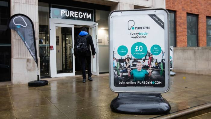 An advertisement stands outside an entrance to a Pure Gym Ltd., a unit of CCMP Capital Advisors LLC in London, U.K., on Tuesday, Jan. 26, 2016. Pure Gym Ltd. hired Rothschild & Co as its considers 400m initial public offering, the Sunday Times reported, citing unidentified sources. Photographer: Simon Dawson/Bloomberg
