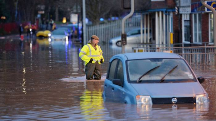 Soldiers walk through flood water in York, after the River Foss bursts its banks