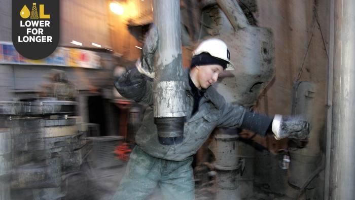 An oil worker in the Priobskoye field operated by Yuganskneftegaz, a unit of Rosneft