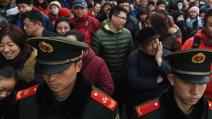 Paramilitary police officers control a crowd as they line up to enter the Yonghegong Lama Temple in Beijing on the first day of the Lunar New Year on February 19, 2015. Millions of Chinese are celebrating Spring Festival, the most important holiday on the Chinese calendar, which this year marks the beginning of the Year of the Sheep.  PHOTO / Greg BAKER