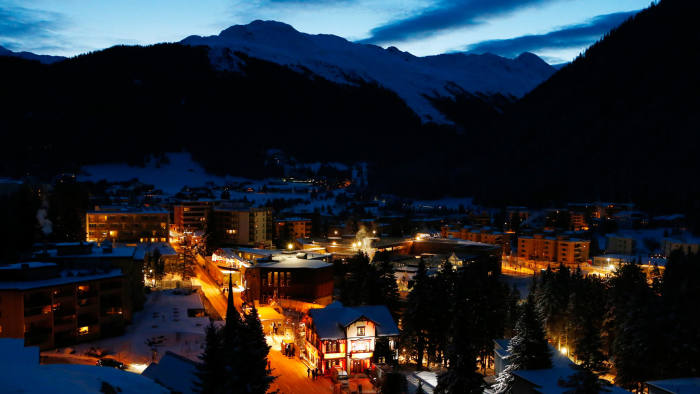 An overview shows the Swiss mountain resort of Davos in the early morning January 21, 2015. More than 1,500 business leaders and 40 heads of state or government will attend the Jan. 21-24 meeting of the World Economic Forum (WEF) to network and discuss big themes, from the price of oil to the future of the Internet. This year they are meeting in the midst of upheaval, with security forces on heightened alert after attacks in Paris, the European Central Bank considering a radical government bond-buying programme and the safe-haven Swiss franc rocketing. REUTERS/Ruben Sprich (SWITZERLAND - Tags: POLITICS BUSINESS)