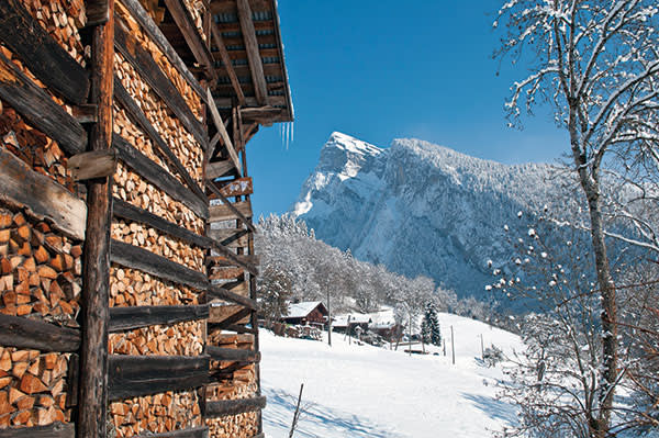 Traditional chalets in the Giffre Valley, with the Aouille de Criou behind