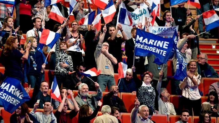 LYON, FRANCE - FEBRUARY 05: Far right supporters attend the launch of National Front Leader Marine Le Pen presidential campaign on February 5, 2017 in Lyon, France. One of the most unpredictable French elections has got underway, with National Front leader promising to protect the electorate from globalization. The 48 year old daughter of the party founder Jean Marie Le Pen has manifesto pledges such as taxing job contracts for non-nationals and proposing to leave the euro zone. (Photo by Jeff J Mitchell/Getty Images)