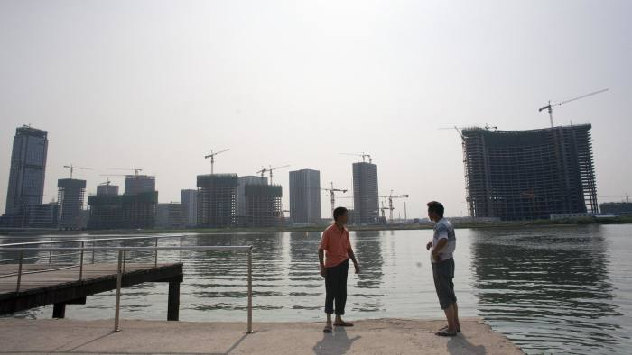 The Conch Bay development stands across the river from the Manhattan-inspired Yujiapu financial district in the Tianjin Binhai New Area CBD of Tianjin, China, on Wednesday, Aug. 10, 2011. A replica of Manhattan, complete with Twin Towers, Lincoln Center and what passes for the Hudson River, is under construction 100 miles (161 kilometers) from Beijing. And like New York City in the 1970s, it may need a bailout. Photographer: Sim Chi Yin/Bloomberg