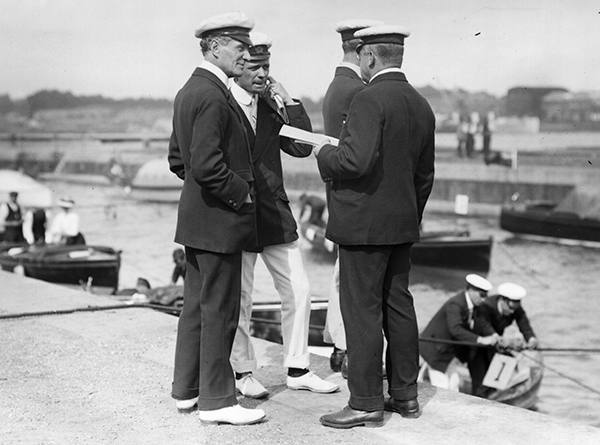 1907: Commander Mansfield Smith-Cumming (later head of the British Secret Service), Professor Redwood and Bernard Redwood at the Motor Yacht Club Reliability Trials on Southampton Water. (Photo by Topical Press Agency/Getty Images)