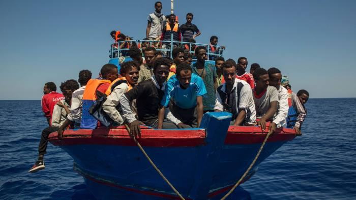Migrants wait to be rescued by the Aquarius rescue ship run by non-governmental organisations (NGO)