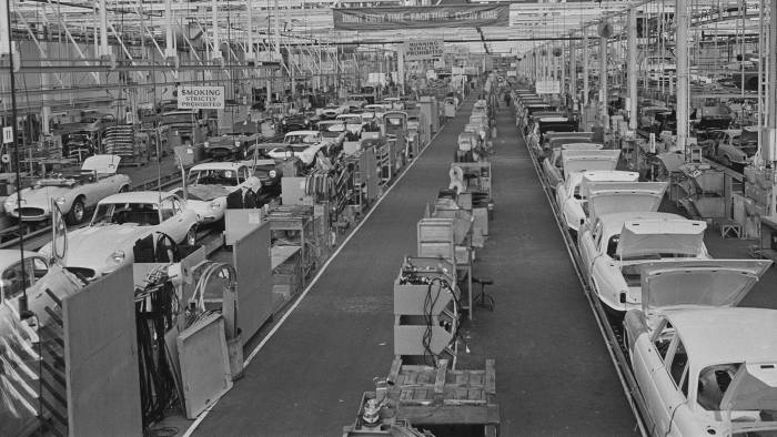 The Browns Lane plant of Jaguar Cars in Coventry, lies idle during power shortages brought about by the 1972 UK miners' strike, 14th February 1972. On the production line are Jaguar E-types and XJ6 models. A banner hanging from the ceiling (centre) reads: 'Right First Time-Each Time-Every Time'. (Photo by Ron Moran/Daily Express/Hulton Archive/Getty Images)
