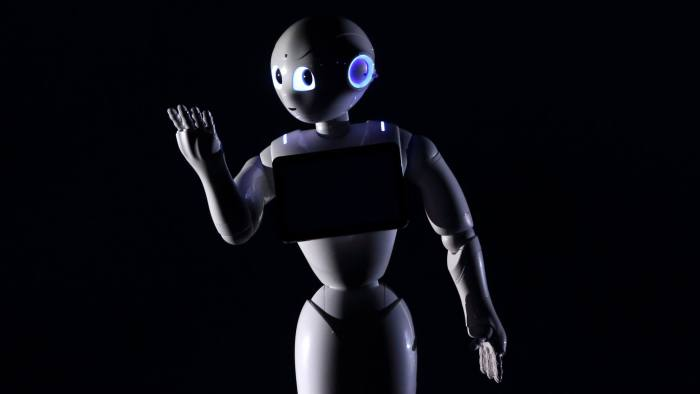 A human-like robot called Pepper, developed by SoftBank Corp.'s Aldebaran Robotics unit, is unveiled during a news conference in Urayasu, Chiba Prefecture, Japan, on Thursday, June 5, 2014. SoftBank plans to sell interactive robots for households from February next year. Photographer: Tomohiro Ohsumi/Bloomberg
