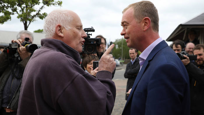 KIDLINGTON, ENGLAND - MAY 03: Protester Malcolm Baker (R), a conservative that voted to leave the European Union, discusses Brexit, agreeing to disagree with Liberal Democrat leader Tim Farron at a campaign event on May 3, 2017 in Kidlington, a village outside of Oxford, England. The country goes back to the polls for the second time in two years as a general election is held on June 8. (Photo by Dan Kitwood/Getty Images)
