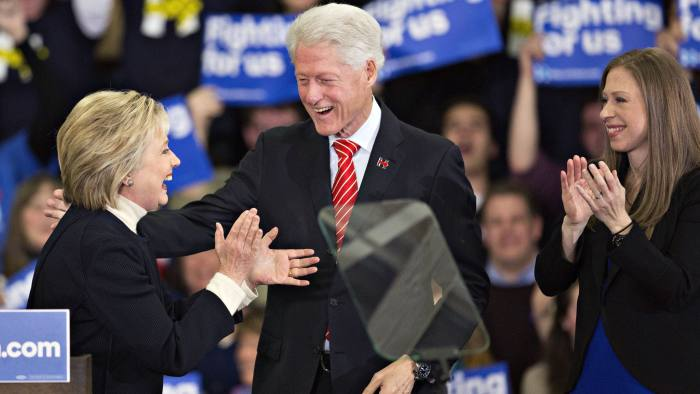 EDITORS NOTE, CAPTION CORRECTION: Hillary Clinton, former Secretary of State and 2016 Democratic presidential candidate, left to right, is joined on stage by her husband Bill Clinton, former U.S. president, and their daughter Chelsea Clinton during a primary night event in Hooksett, New Hampshire, U.S., on Tuesday, Feb. 9, 2016. Clinton congratulated Senator Bernie Sanders, an independent from Vermont and 2016 Democratic presidential candidate, on his victory in her concession speech in Hooksett and vowed to battle on, saying she knows how to get results voters are demanding. Photographer: Daniel Acker/Bloomberg *** Local Caption *** Hillary Clinton; Bill Clinton; Chelsea Clinton