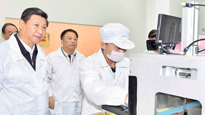 Chinese President Xi Jinping (left) visits a local factory affiliated to TPK, a touch solution provider from southeast China's Taiwan, in Pingtan, southeast China's Fujian Province, Nov. 1, 2014