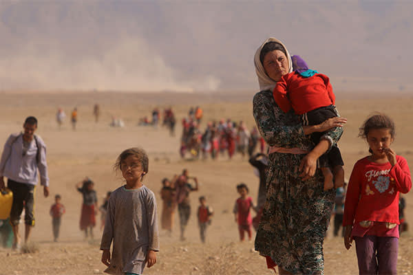 Yazidis flee Sinjar in northern Iraq on August 11 2014
