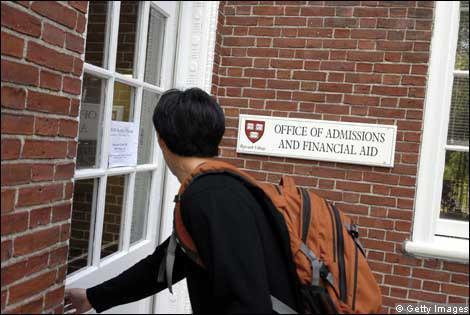 A student walks through a door in a graduate school