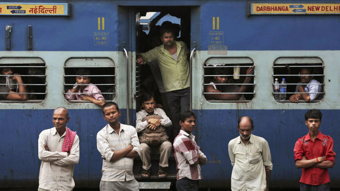 Indian stranded passengers wait for the train services to resume following a power outage in New Delhi
