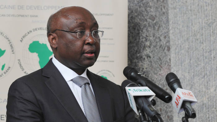 The president of the African Development Bank (AfDB) Donald Kaberuka delivers a speech during a ceremony on September 8, 2014 in Abidjan, marking the return of the AfDB headquarters in the Ivorian capital. The African Development Bank had been relocated to Tunisia for more than a decade due to political instability in Ivory Coast. AFP PHOTO / SIA KAMBOU