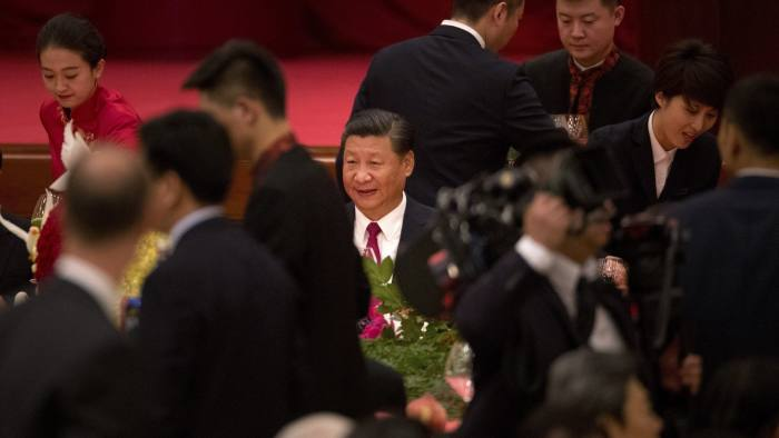 China's President Xi Jinping smiles during a reception at the Great Hall of the People on the eve of the Oct. 1, National Day holiday in Beijing, Saturday, Sept. 30, 2017. (AP Photo/Mark Schiefelbein)