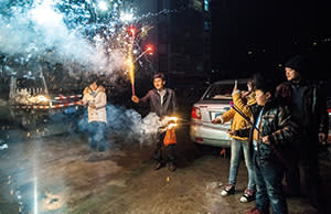 Xiang Ju's family celebrating Chinese New Year with fireworks