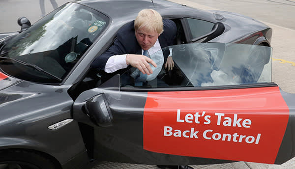 LEEDS, ENGLAND - MAY 23: Boris Johnson MP emerges from a sports car after it performed 'donuts' during a visit to Ginetta Sports cars as part of the Brexit Battle Bus tour in Yorkshire on May 23, 2016 in Leeds, England. Boris Johnson and the Vote Leave campaign are touring the UK in their Brexit Battle Bus. The campaign is hoping to persuade voters to back leaving the European Union in the Referendum on the 23rd June 2016. (Photo by Christopher Furlong/Getty Images)