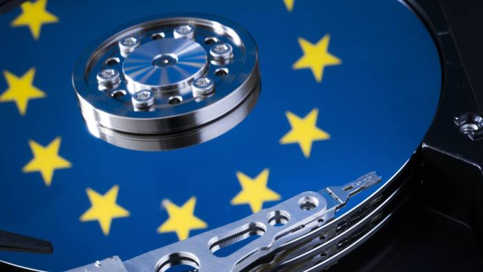 BERLIN, GERMANY - JANUARY 29: Symbolic photo for data protection, reflection of the flag of the European Union in a computer hard drive on January 29, 2015 in Berlin, Germany. (Photo by Thomas Trutschel/Photothek via Getty Images)
