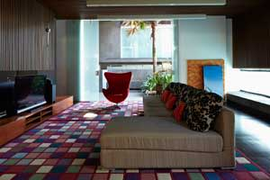 The sitting room with a red Arne Jacobsen Egg chair