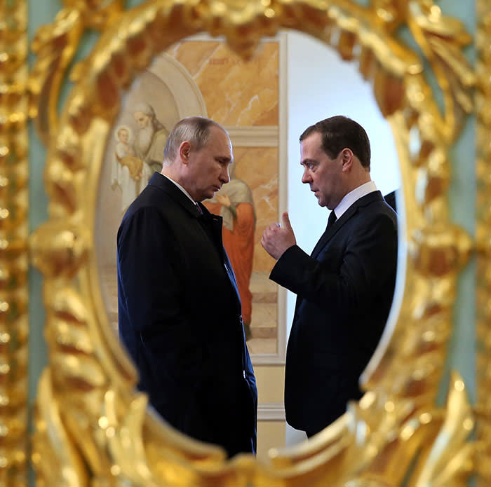 Russian President Vladimir Putin, left, and Prime Minister Dmitry Medvedev talk to each other while visiting the New Jerusalem Resurrection Monastery in Istra, about 70 kilometers ( 44 miles) east of Moscow, Russia, Wednesday, Nov. 15, 2017. (Yekaterina Shtukina, Sputnik, Government Pool Photo via AP)