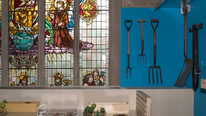 Gardening artefacts next to a stained-glass window