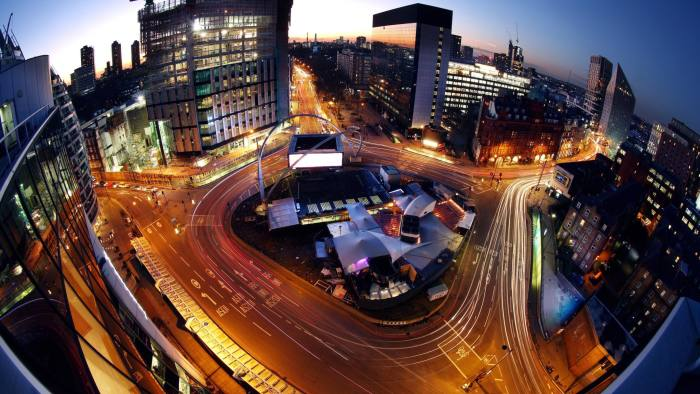 Light trails made by traffic passing around the Old Street roundabout, also referred to as 'Silicon Roundabout,' in the area known as 'Tech City' at dusk in London, U.K., on Friday, Jan. 15, 2016. Growing peer-to-peer lending and online money transfer services helped raise a record $3.6 billion in venture capital funding for the U.K.'s technology sector last year, according to data compiled by London & Partners. Photographer: Chris Ratcliffe/Bloomberg