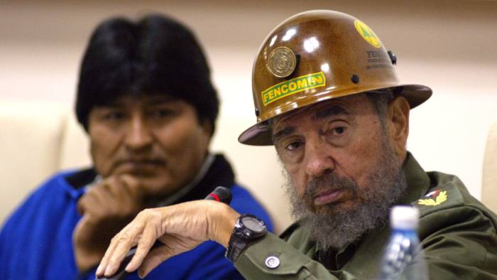 CASTRO MORALES...Bolivian President-elect Evo Morales listens as Cuban President Fidel Castro, wearing a miner's helmet that Morales gave him, speaks to Bolivian students in Havana, Cuba, Friday, Dec. 30, 2005. Morales and an ebullient Fidel Castro gathered late Friday with scores of young Bolivians studying in Cuba as the Indian nationalist began reaching out to other government leaders even before he takes office. (AP Photo/Javier Galeano)