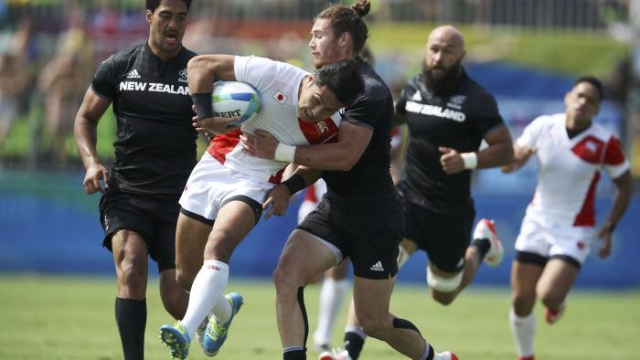 2016 Rio Olympics - Rugby - Preliminary - Men's Pool C New Zealand v Japan - Deodoro Stadium - Rio de Janeiro, Brazil - 09/08/2016. Katsuyuki Sakai (JPN) of Japan is tackled by Gillies Kaka (NZL) of New Zealand. REUTERS/Phil Noble (BRAZIL - Tags: SPORT OLYMPICS SPORT RUGBY) FOR EDITORIAL USE ONLY. NOT FOR SALE FOR MARKETING OR ADVERTISING CAMPAIGNS.