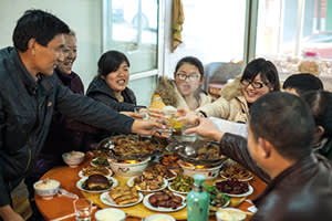 Xiang Ju's family sharing a traditional feast