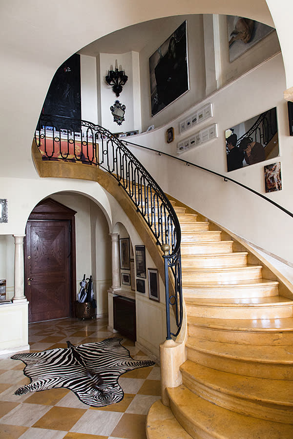Marble staircase and a zebra hide in the hallway