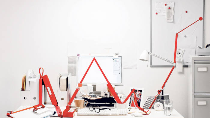 Red graph line made from objects in office desk, graph indicates improvement