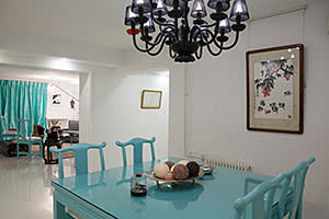 Dining area with furniture from Tiffany's and a painting by Xu Shulin