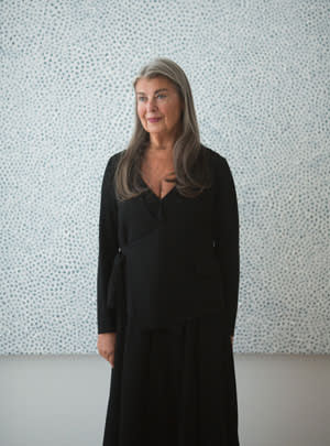 Victoria Miro at her new gallery in Mayfair, with one of Yayoi Kusama's 'White Infinity Nets' paintings