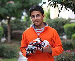 Shubham Banerjee, aged 13, with his Lego-kit Braille printer