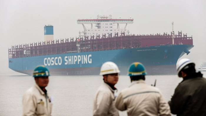 This picture taken on January 5, 2018 shows Chinese employees looking at a China's homegrown 20,000 TEU-class container vessel in Nantong in China's Jiangsu province on January 16, 2018. / AFP PHOTO / - / China OUT (Photo credit should read -/AFP/Getty Images)