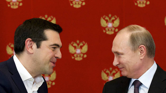 Russian President Vladimir Putin (R) and Greek Prime Minister Alexis Tsipras attend a signing ceremony at the Kremlin in Moscow April 8, 2015. Tsipras did not ask for financial aid at talks in Moscow on Wednesday but Russia could provide credits for large joint projects in the future, Putin said. REUTERS/Alexander Zemlianichenko/Pool