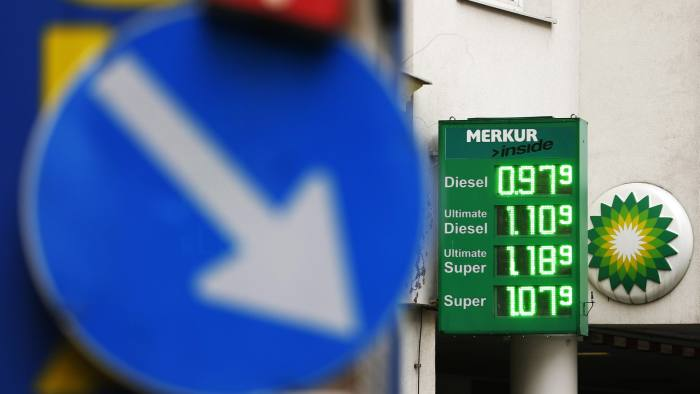 The price table of a BP oil and gas station is pictured behind a road sign in Vienna, Austria, February 1, 2016. The price of basic unleaded petrol (Super) is 1.079 Euros ($ 1.172) per litre. REUTERS/Heinz-Peter Bader - RTS95JP