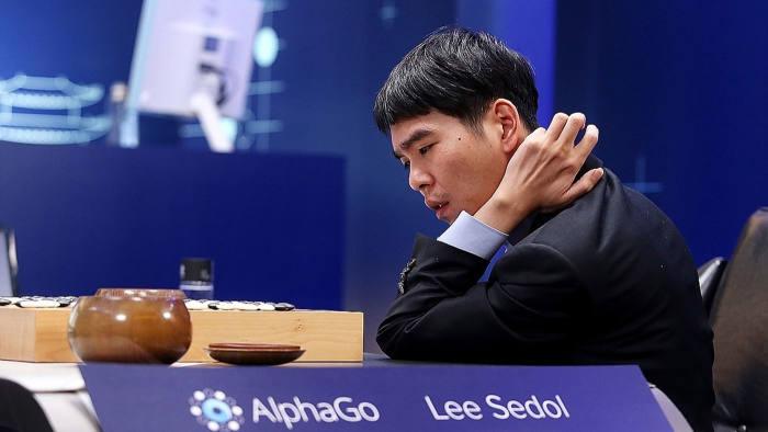 In this handout image provided by Google, South Korean professional Go player Lee Se-Dol reviews the match after the fourth match against Google's artificial intelligence program, AlphaGo, during the Google DeepMind Challenge Match on March 13, 2016 in Seoul, South Korea