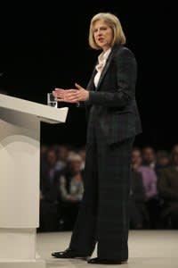 Wearing a Vivienne Westwood tartan trouser suit