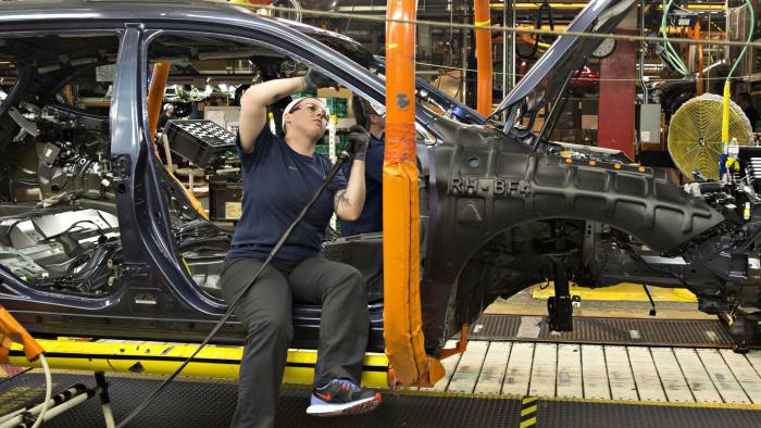 An employee installs a side curtain airbag in a Subaru Outback on the assembly line at the Subaru of Indiana Automotive Inc., a wholly-owned subsidiary of Fuji Heavy Industries Ltd., manufacturing facility in Lafayette, Indiana, U.S., on Wednesday, May 25, 2016. The U.S. Census Bureau is scheduled to release factory orders figures on June 3. Photographer: Daniel Acker/Bloomberg