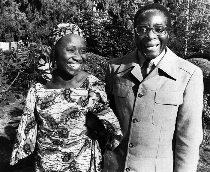 Smiling happily, Robert Mugabe, Rhodesian President Designate and his Ghanaian wife, Sally, hold hands in the rose garden of their Salisbury bungalow, Zimbabwe, on March 6, 1980, during a brief interlude between continuous business visits as Mugabe worked at forming a Government following his party's landslide electoral victory. (AP Photo/Louise Gubb)